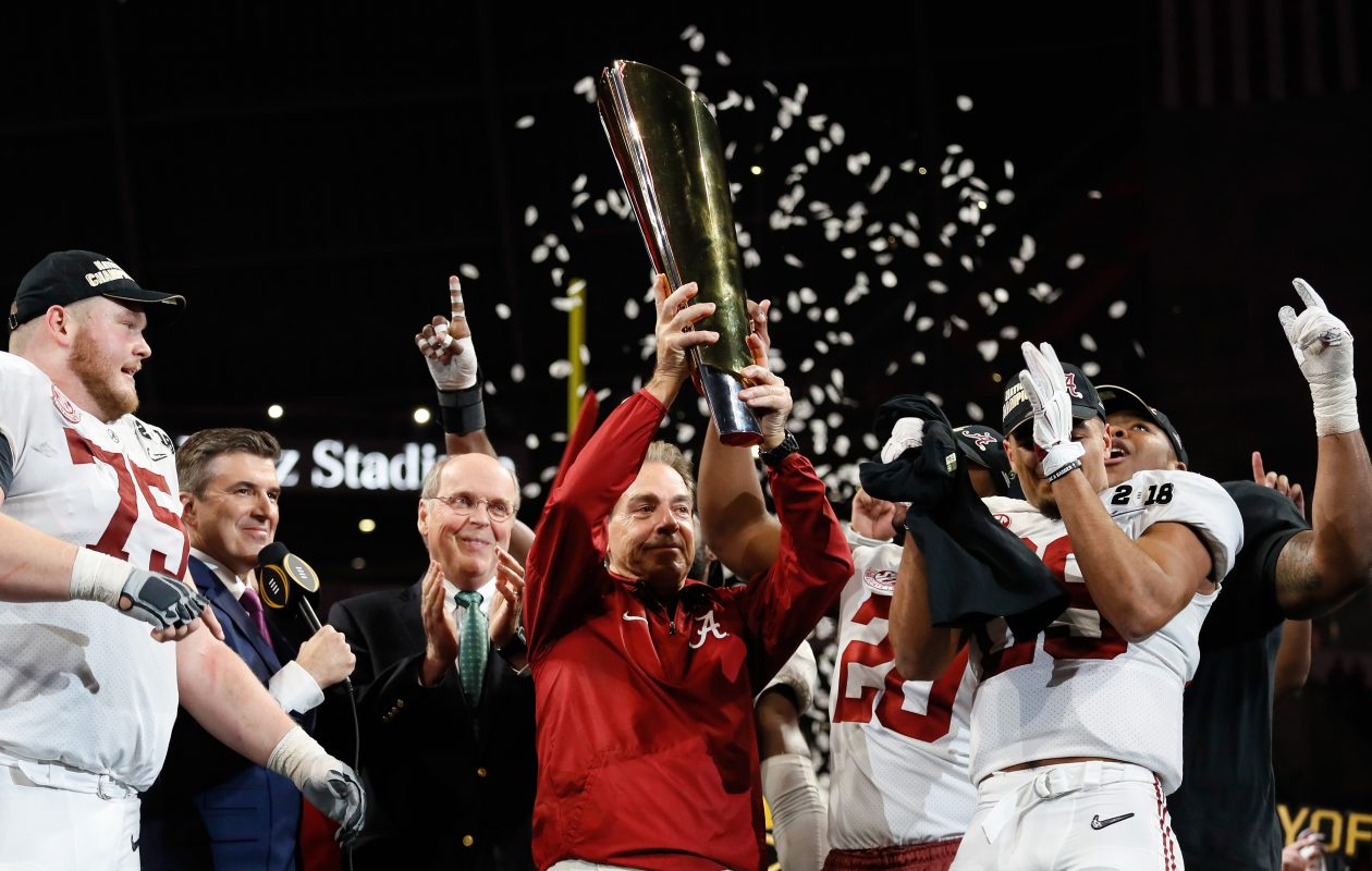 Coach Nick Saban of the Alabama Crimson Tide holds the trophy while celebrating with his team after defeating the Georgia Bulldogs in overtime to win the CFP National Championship   (Jamie Squire/Getty Images)