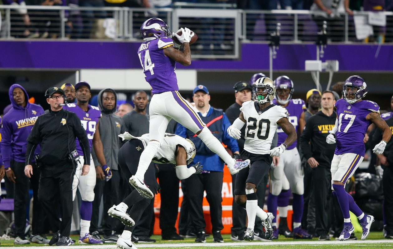 Stefon Diggs of the Minnesota Vikings makes a catch over Marcus Williams of the New Orleans Saints   (Jamie Squire/Getty Images)