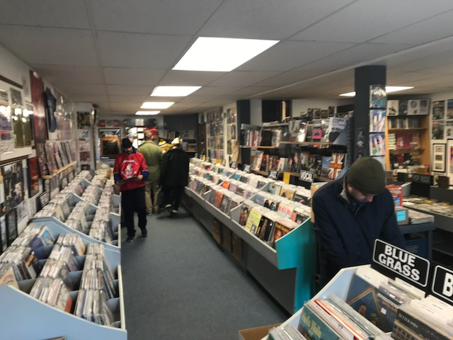 Customers shop at Cool Beat Music and Books.