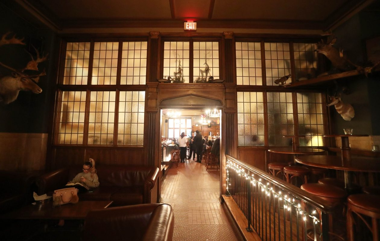 One of the Hotel @ the Lafayettes businesses, The Lafayette Brewing Company, is filled with the feeling of the Teddy Roosevelt era. Much of the space has been restored. (Sharon Cantillon/Buffalo News)