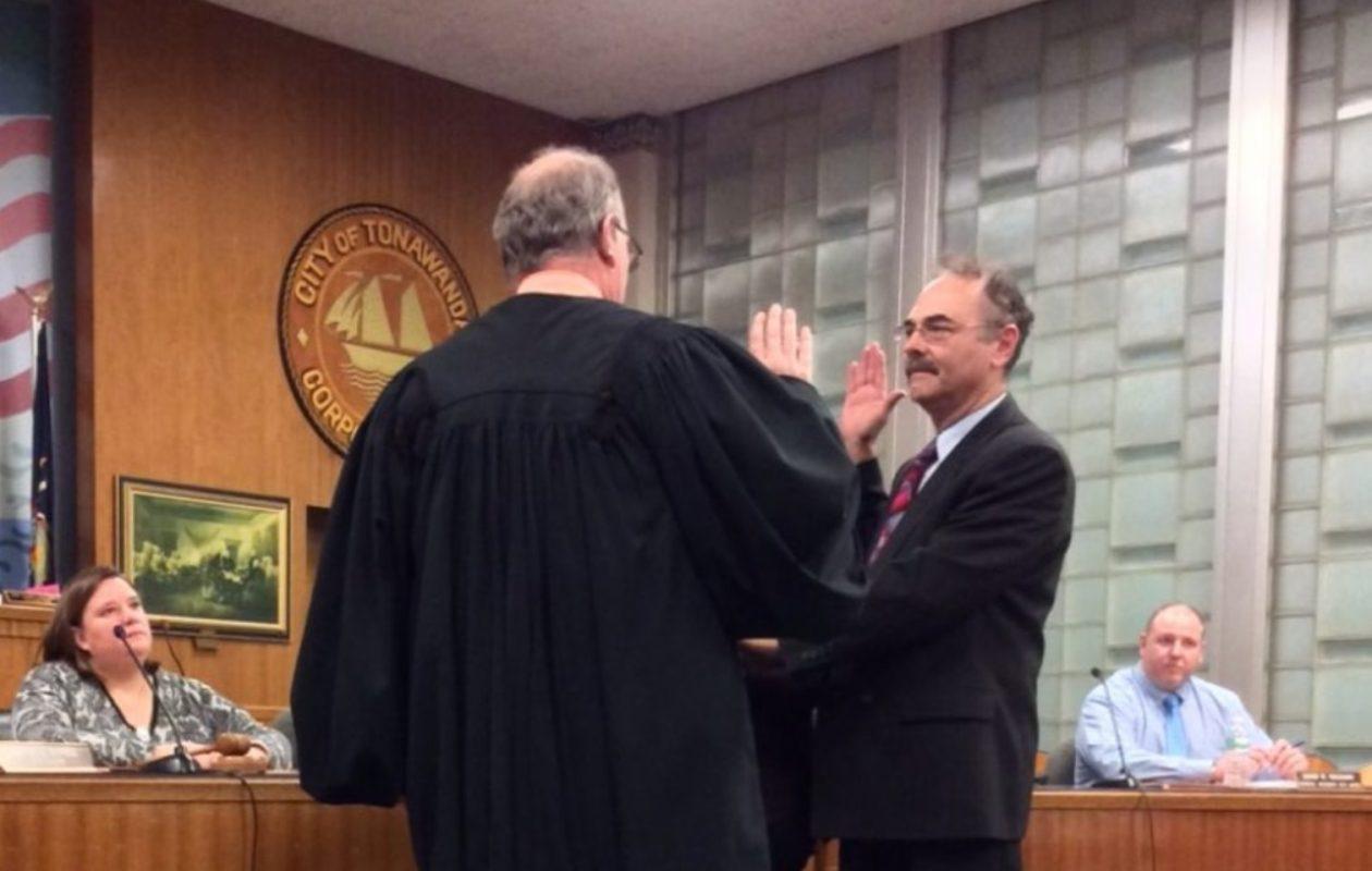 Judge Michael Saltarelli, left, swears in Deputy City Attorney Michael Rua, on Jan. 3, 2018.