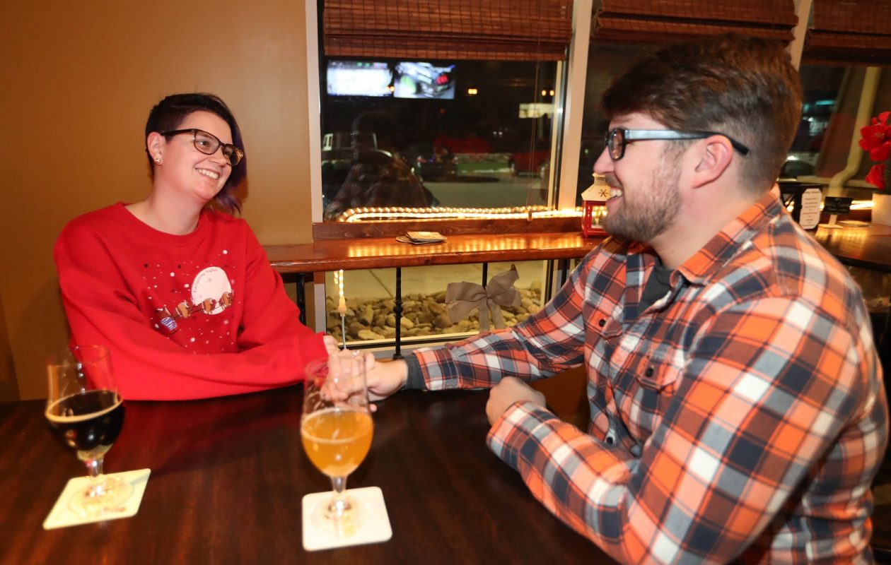 Katie Behan, left, and her fiance Tommy Creenan, of Williamsville, hang out in Murphy Brown's. (Sharon Cantillon/Buffalo News)