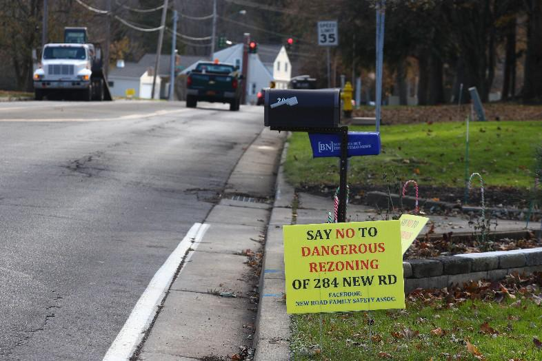 Anti-development signs dot lawns in the neighborhood near 284 New Road, where Natale Builders plans to construct up to 80 houses, in this November photo. (John Hickey/The Buffalo News)