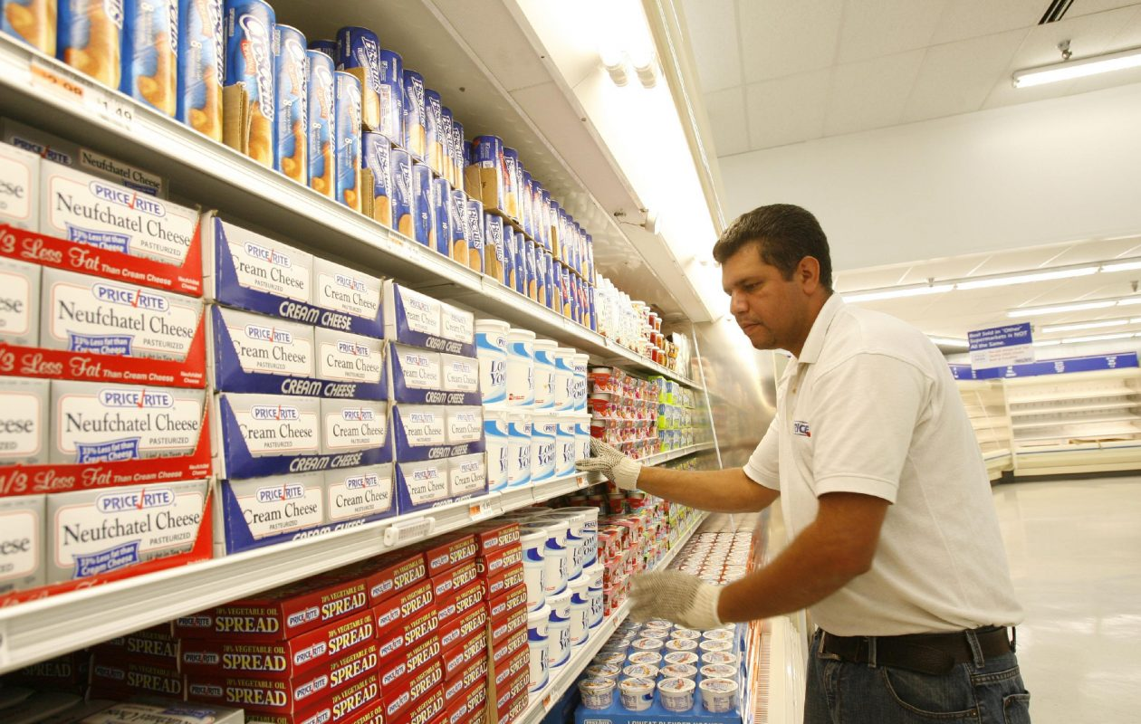 Employee Alexis DiLone stocks shelves at the Price Rite on Kenmore Avenue in Buffalo around the time of the store's opening in 2009. (Sharon Cantillon/News file photo)