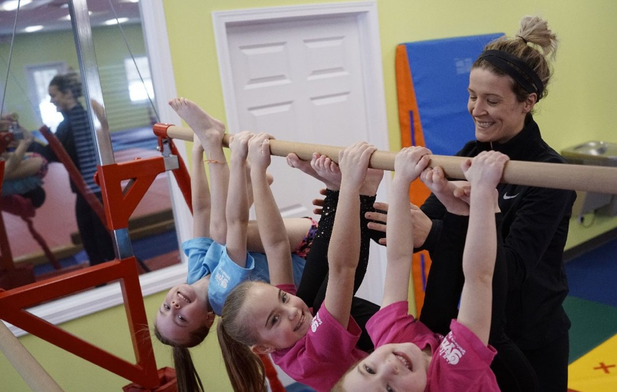 """Whenever the kids were my patients, it was the best part of my day,"" says Rachel Daving, a former dental hygienist and owner of The Little Gym of Williamsville, with, from left, the three Kagels sisters, Audriana, 6, Alexis 8, and Abigail,  4. (Derek Gee/Buffalo News)"