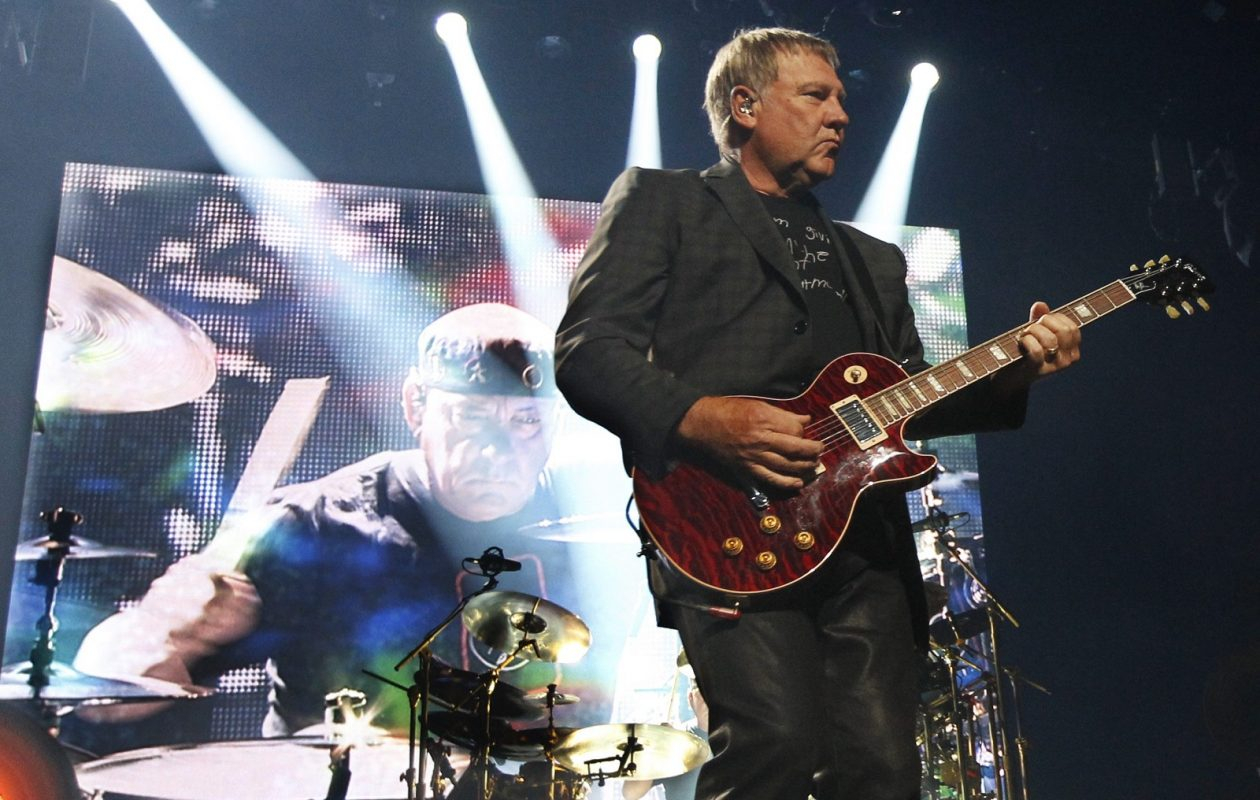 Rush played to a sold-out crowd in 2015 in the First Niagara Center. Alex Lifeson is on guitar and Neil Peart on drums.  (Sharon Cantillon/Buffalo News file photo)