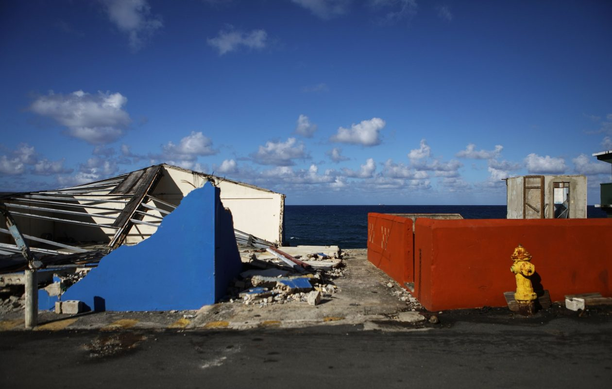 Structures mostly destroyed by Hurricane Maria in San Juan, Puerto Rico. Barely three months after Hurricane Maria made landfall, approximately one-third of the devastated island remained without electricity. (Mario Tama/Getty Images)