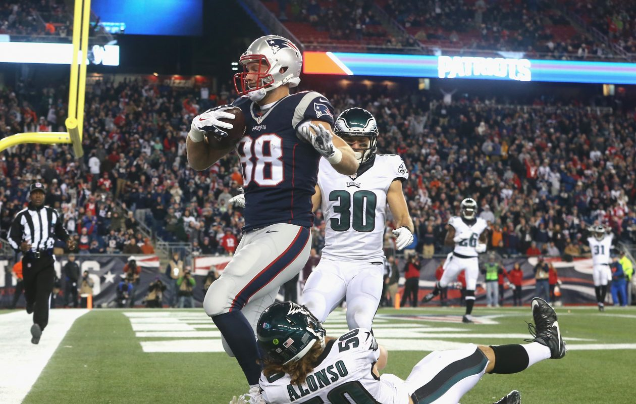 Former NFL tight end Scott Chandler, scoring a touchdown, got to know new Bills offensive coordinator Brian Daboll when Daboll coached the Patriots' tight ends.  (Getty Images)