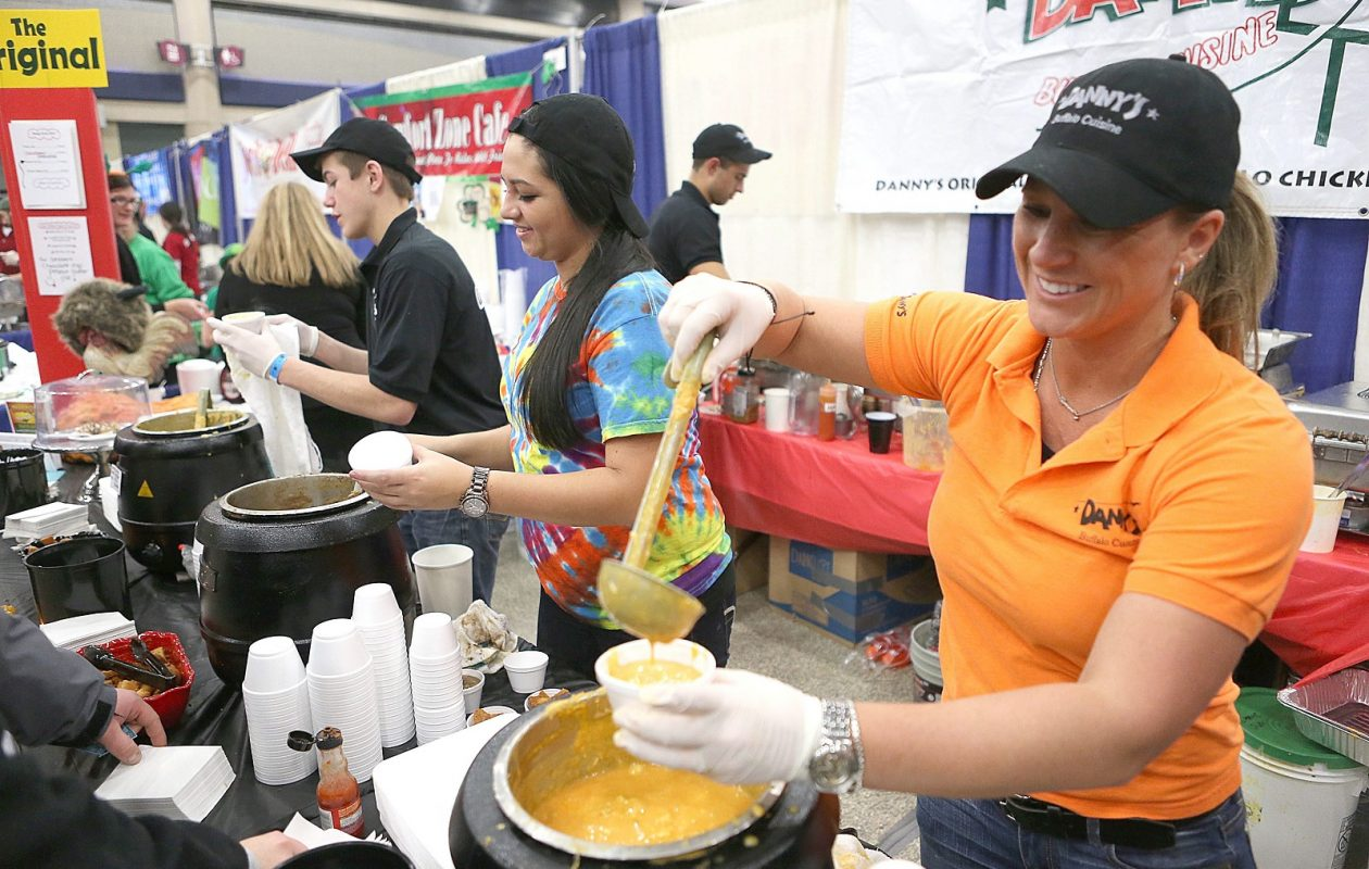 Melinda Ebeling, right, and Melissa Schaumloeffel of Dannys are pictured dishing out soup at Soup-Fest in 2014. The event returns for another year.  (Robert Kirkham/Buffalo News)