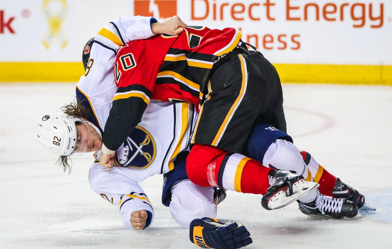 Sabres defenseman Nathan Beaulieu left with a possible concussion just 3:11 into the game after fighting Calgary's Curtis Lazar. (USA Today Sports)
