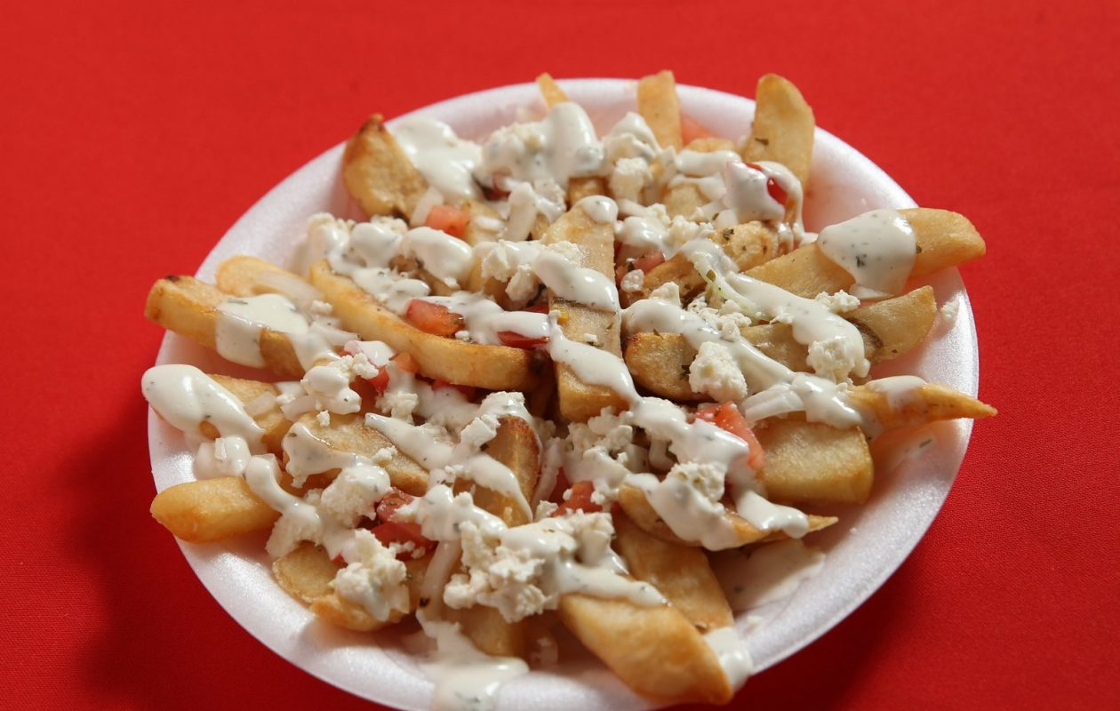 Venus serves Greek fries with tomato, onions, feta cheese, Greek dressing and garlic sauce. (Sharon Cantillon/Buffalo News)