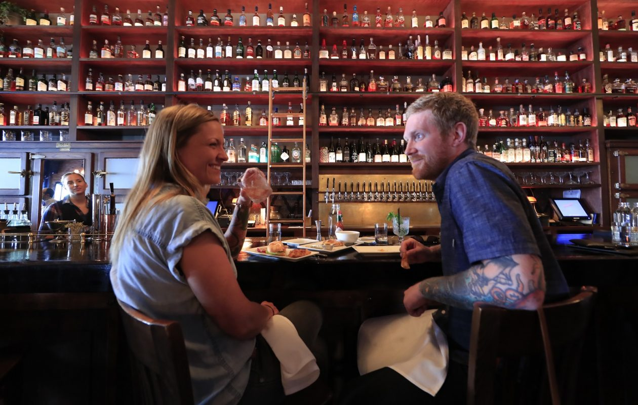 Jenny Miller and Josh Mullin enjoy a beverage at  Lucky Day. (Harry Scull Jr./Buffalo News)