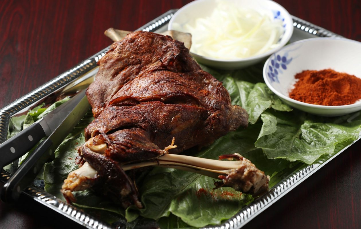 Xi An Gourmet's roasted lamb leg, which is a substantial four or five pounds before cooking, is marinated in spices for an hour and cooked for another hour, which requires a two-hour pre-order. (Sharon Cantillon/Buffalo News)