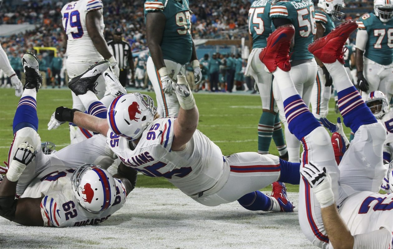 Kyle Williams celebrates his touchdown Sunday in Miami. (James P. McCoy/The Buffalo News)
