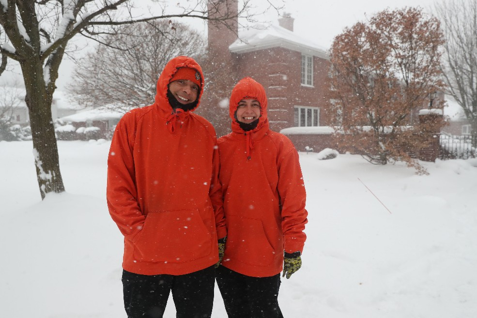 Buffalo News carriers Duaine and Michelle Miller in front of the Mill Manor condominiums in Williamsville, where they rescued an elderly customer they found face down in the snow early Monday as they were delivering papers. (Sharon Cantillon/Buffalo News)