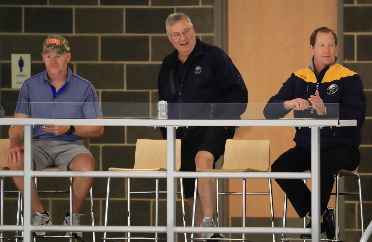 Bills coach Sean McDermott, owner Terry Pegula and Sabres coach Phil Housley watch a development camp practice at HarborCenter in July (Harry Scull Jr./Buffalo News).