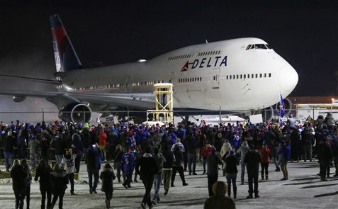 Fans greet Bills at the airport, kicking off New Year with Buffalo's first postseason celebration in 17 years. (Derek Gee/Buffalo News)