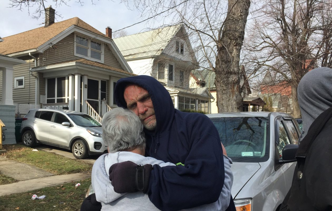 "A neighbor comforts Joe Conti whose 7-year-old son, Anthony, died in a fire in Lovejoy Monday morning. ""I failed him,"" he said crying. (Maki Becker/Buffalo News)"