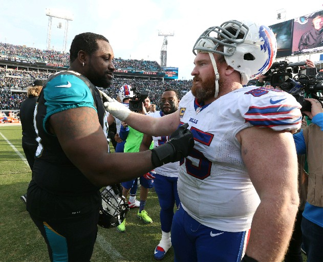 Bills defensive tackle Kyle Williams greets former teammate Marcell Dareus on Sunday. (James P. McCoy/Buffalo News)