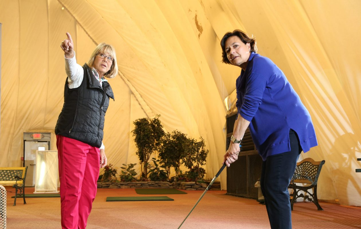 Golf Pro Cindy Miller, left, gives a lesson at the Wehrle Golf Dome.   (Sharon Cantillon/Buffalo News file photo)