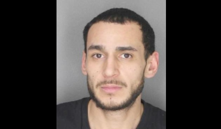 Jose D. Ruiz Camacho, 29, faces a fourth-degree arson charge. (Photo courtesy Erie County Sheriff's Office)