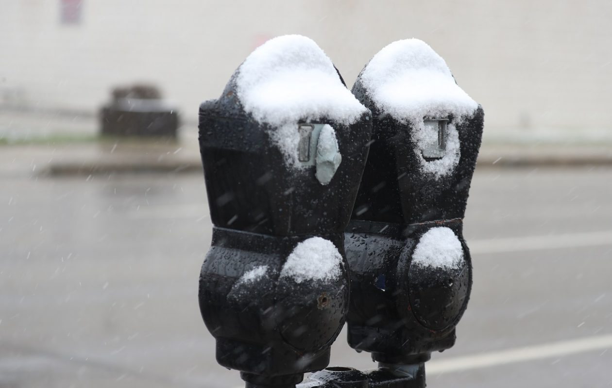 Snow covers parking meters   on Oak Street in downtown Buffalo. (John Hickey/News file photo)