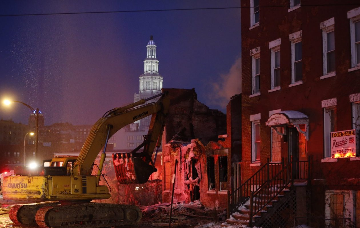 Demolition is underway at 68 Sycamore St. Wednesday morning after a fire broke out at 3 a.m. (Derek Gee/Buffalo News)