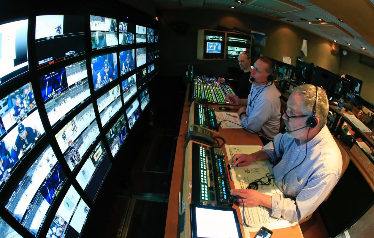 The Sabres' production truck Thursday featured, from near to far, producer Joe Pinter, director Eric Grossman and technical director Mike Buttino. (Harry Scull Jr./Buffalo News)