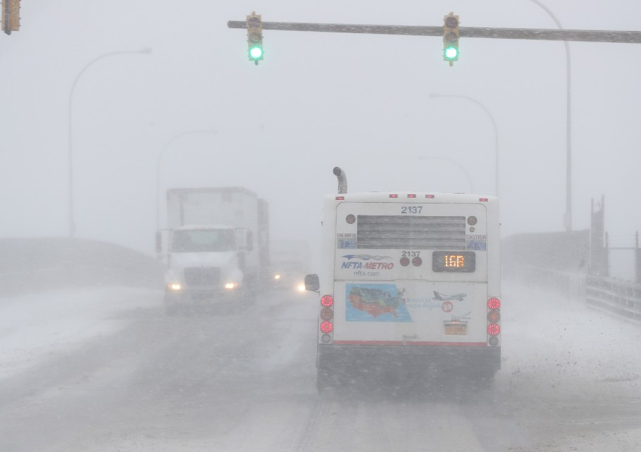 High winds and blowing snow reduced visibility and made driving hazardous Tuesday afternoon, prompting City Hall and County Hall to close early. (Sharon Cantillon/Buffalo News)