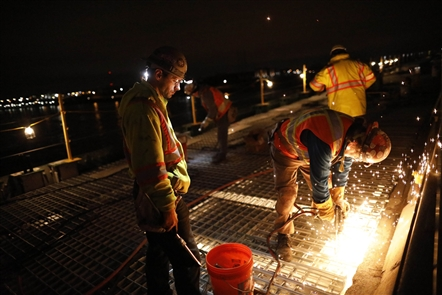Braving the elements to redeck the Peace Bridge