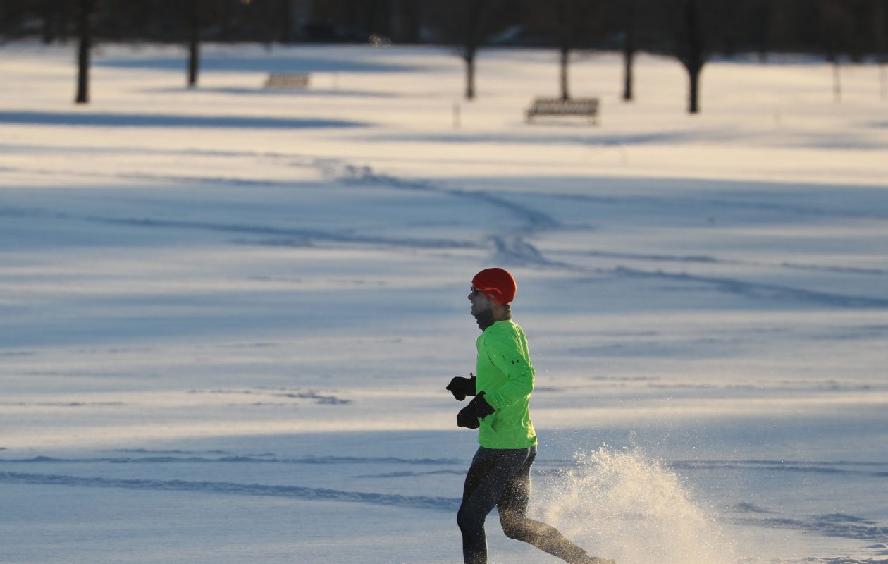 Will Chesebro, of Kenmore,  goes running in his snow shoes around Delaware Park this week. (Sharon Cantillon/Buffalo News)
