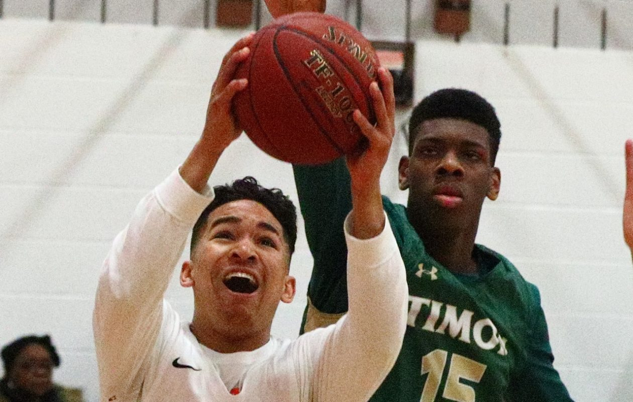 Parks Noah Hutchins scores two points over Timon-St. Judes Master Radford during Friday nights clash at The Park School.  (James P. McCoy / Buffalo News)