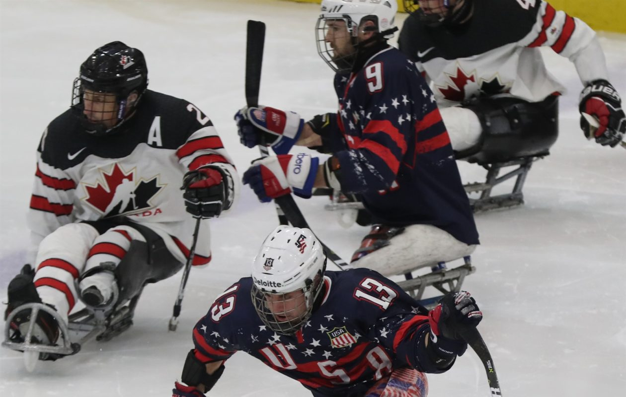 USA's Luke McDermott, who plays for the Buffalo Sabres sled hockey team, skates for the puck.	(James P. McCoy/Buffalo News)
