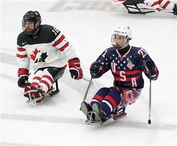 Team USA and Team Canada sled hockey
