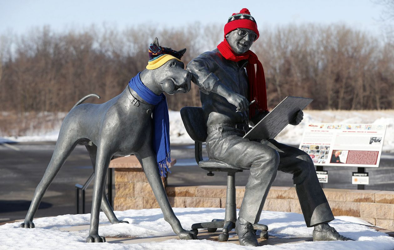 Don Paul doesn't expect winter weather gear to be as necessary the rest of the month for the Brad Anderson and Marmaduke statue in Brocton. (Mark Mulville/News file photo)