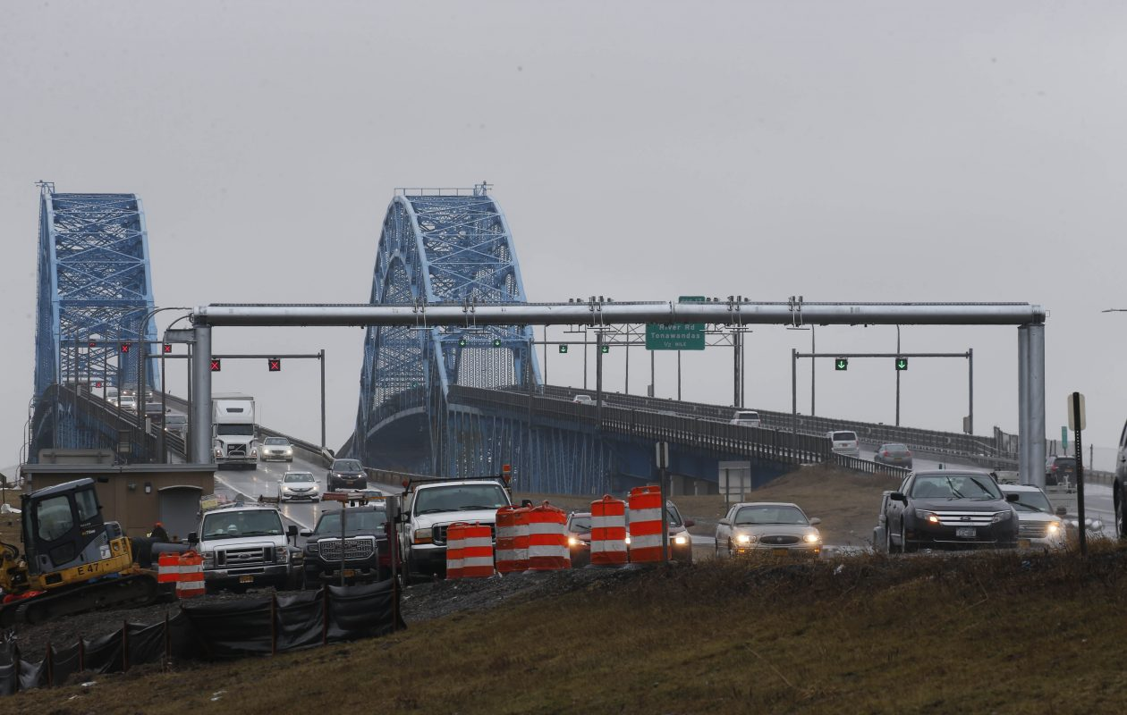 Workers are installing a gantry that will hold equipment for a cashless toll collection system on the I-190 at the South Grand Island Bridge, Wednesday, Feb. 21, 2018. (Derek Gee/Buffalo News)
