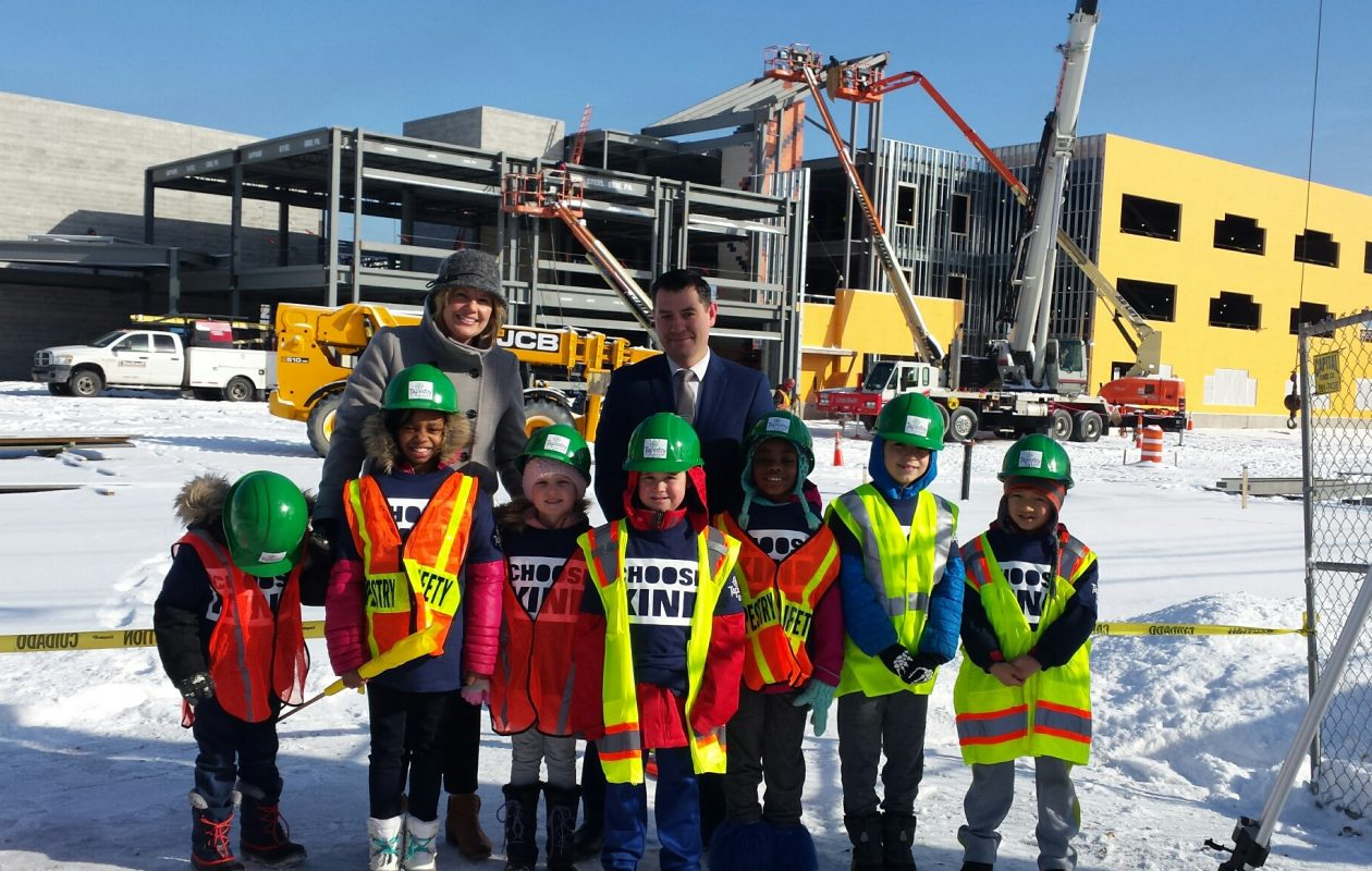 Students from Tapestry Charter School gather for the topping-off of construction on the new elementary school building behind them. (Jonathan D. Epstein/Buffalo News)