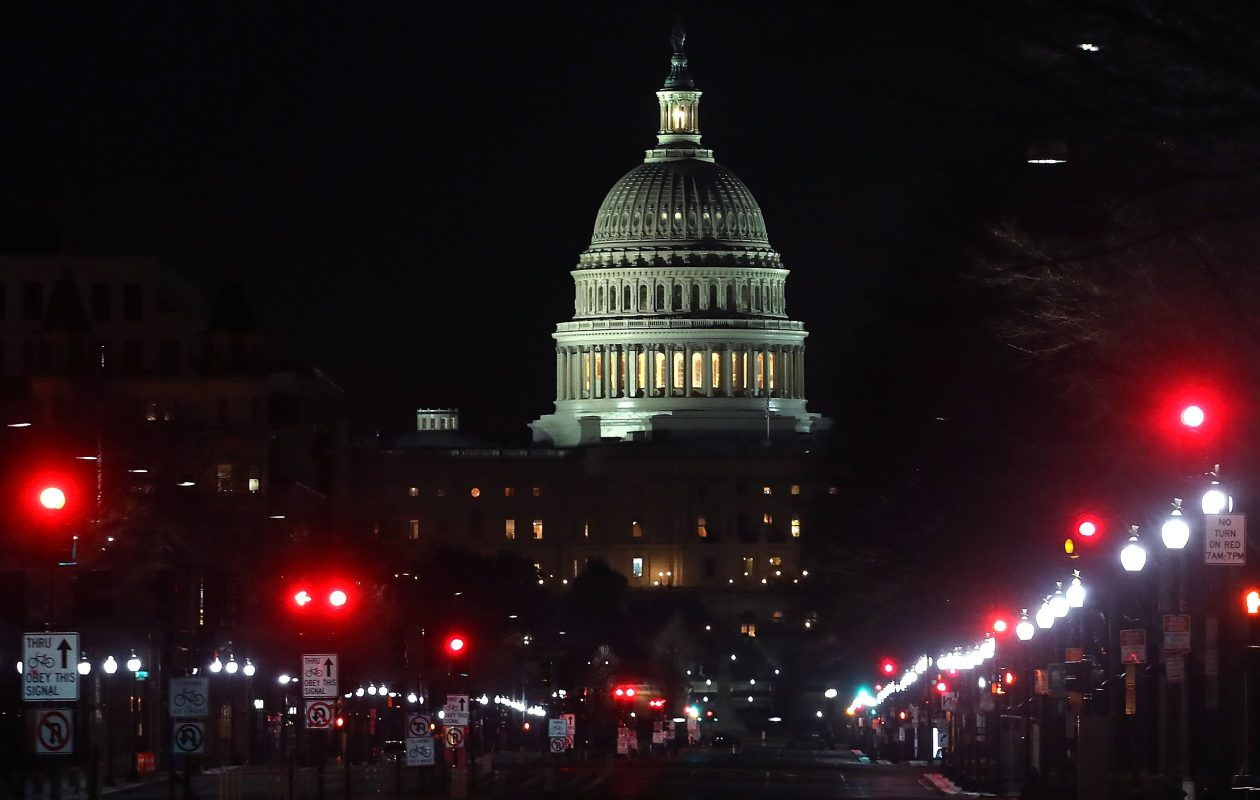 Lights shine down Pennsylvania Avenue leading to the U.S. Capitol in the early hours of Friday morning where the House of Representatives approved a two-year spending bill just before dawn Friday. (Getty Images)