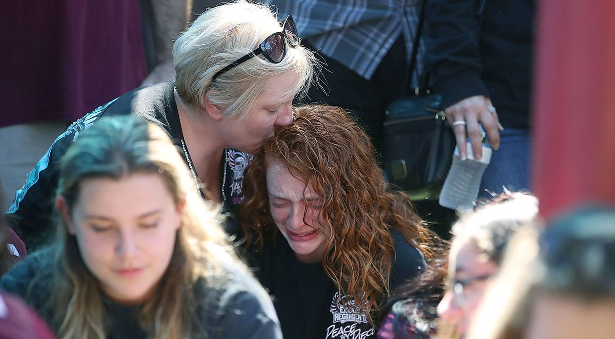 Alyssa Kramer, 16, gets a hug from her mother Tonja Kramer during a prayer vigil for families of Marjory Stoneman Douglas High School, where 17 people were killed last week in a mass shooting in Parkland, Fla. (Photo by Mark Wilson/Getty Images)