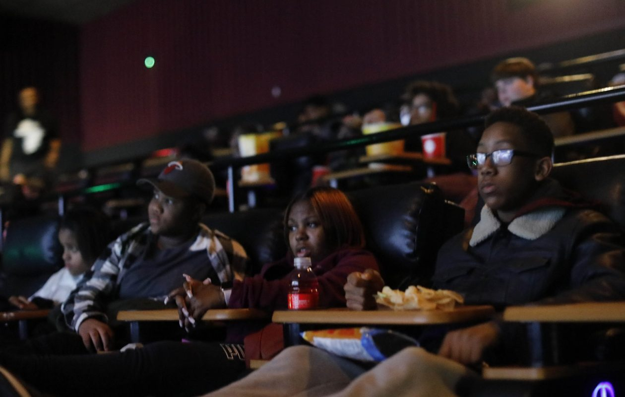 Teens take advantage of donated tickets to watch Black Panther at Regal Elmwood Cinemas. The tickets were donated by local officials, including Mayor Byron Brown and Assemblywoman Crystal Peoples-Stokes.  (Derek Gee/Buffalo News)