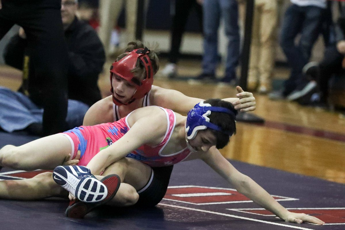 Niagara Wheatfield's Colin Coughenour defeats Grand Island's Brian Bielec in the Section VI Division I 99-pound class championship match Saturday night at North Tonawanda High School. (James P. McCoy/Buffalo News)