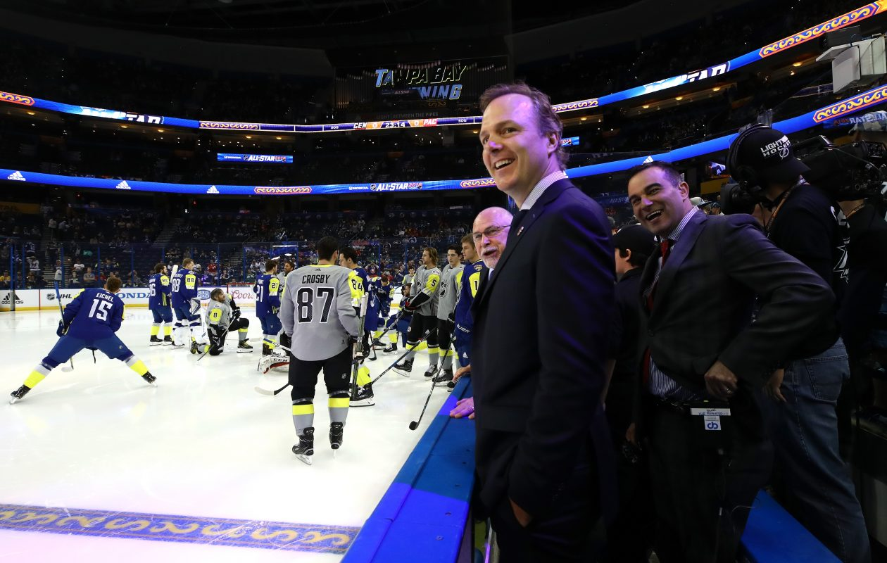 As Jack Eichel (15) and Sidney Crosby (87) warm up in the background, Tampa Bay and Atlantic Division coach Jon Cooper has a laugh with his staff prior to the All-Star Game Jan. 28 in Amalie Arena (Getty Images).