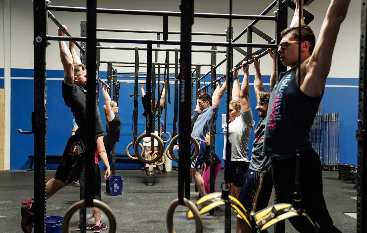 At CrossFit Amherst, workouts focus on functional movements that mimic everyday action (pushing, climbing, squatting) at high intensity. Coach-led workouts change daily. (Dave Jarosz)