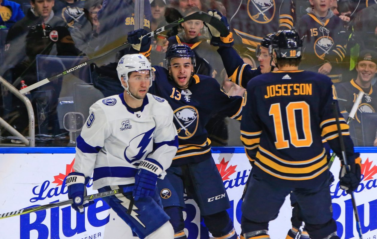Sabres right wing Nick Baptiste (13) scored the opening goal against Tampa Bay and Tyler Johnson on Tuesday. (Harry Scull Jr./Buffalo News)