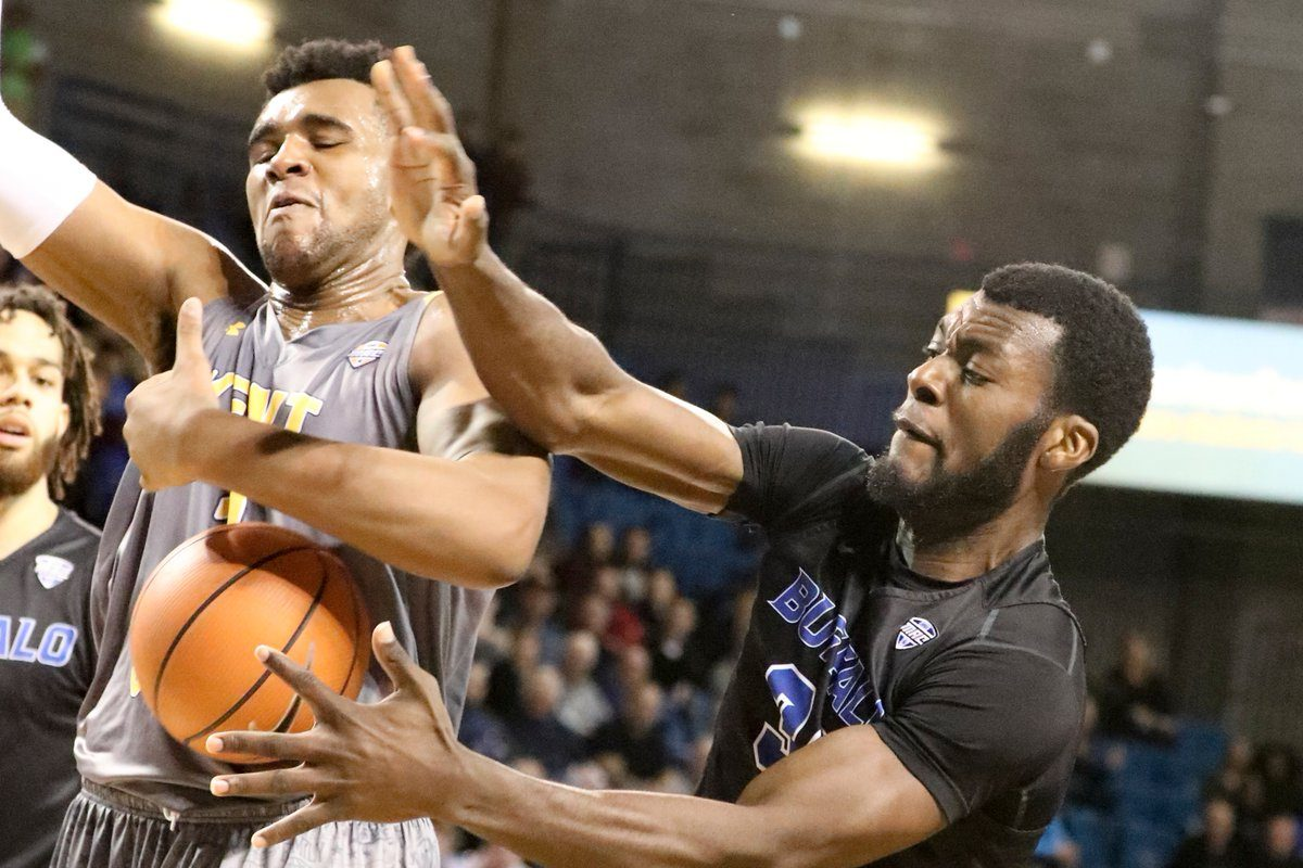 Buffalo Bulls forward Ikenna Smart (34) rebounds the ball away from Kent State Golden Flashes center Adonis De La Rosa (1) in the first half at University at Buffalo Alumni Arena in Amherst in N.Y. on Tuesday, Feb. 13, 2018.  (James P. McCoy / Buffalo News)