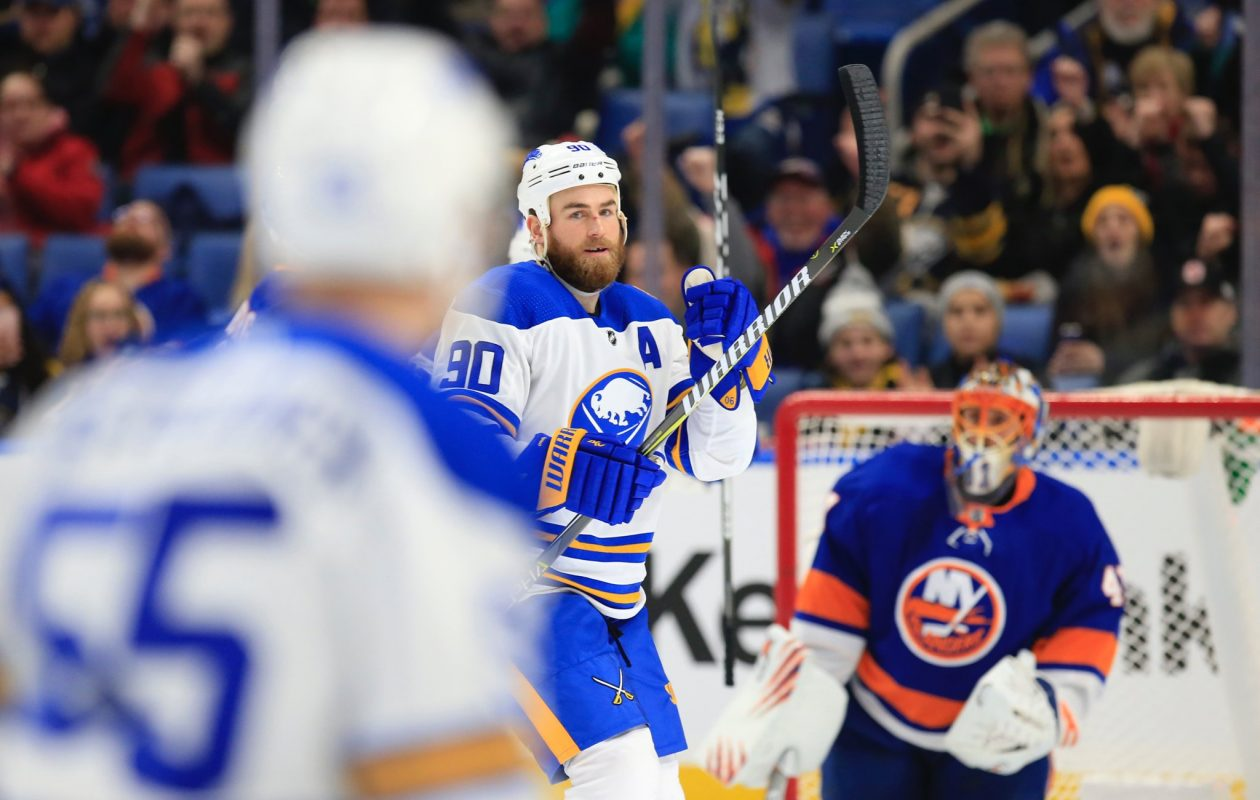 Ryan OReilly, center, tipped Rasmus Ristolainens second-period shot for a power-play goal on Islanders goalie Jaroslav Halak. (Harry Scull Jr./Buffalo News)
