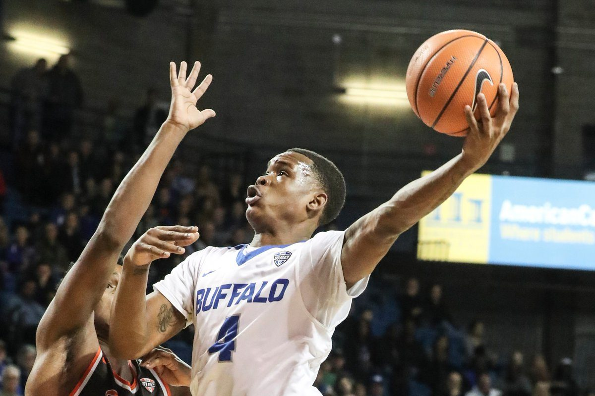 Buffalo Bulls guard Davonta Jordan (4) scores two points over Bowling Green Falcons guard Justin Turner (10) in the first half at University at Buffalo Alumni Arena in Amherst in N.Y. on Friday, Feb. 16, 2018. (James P. McCoy / Buffalo News)