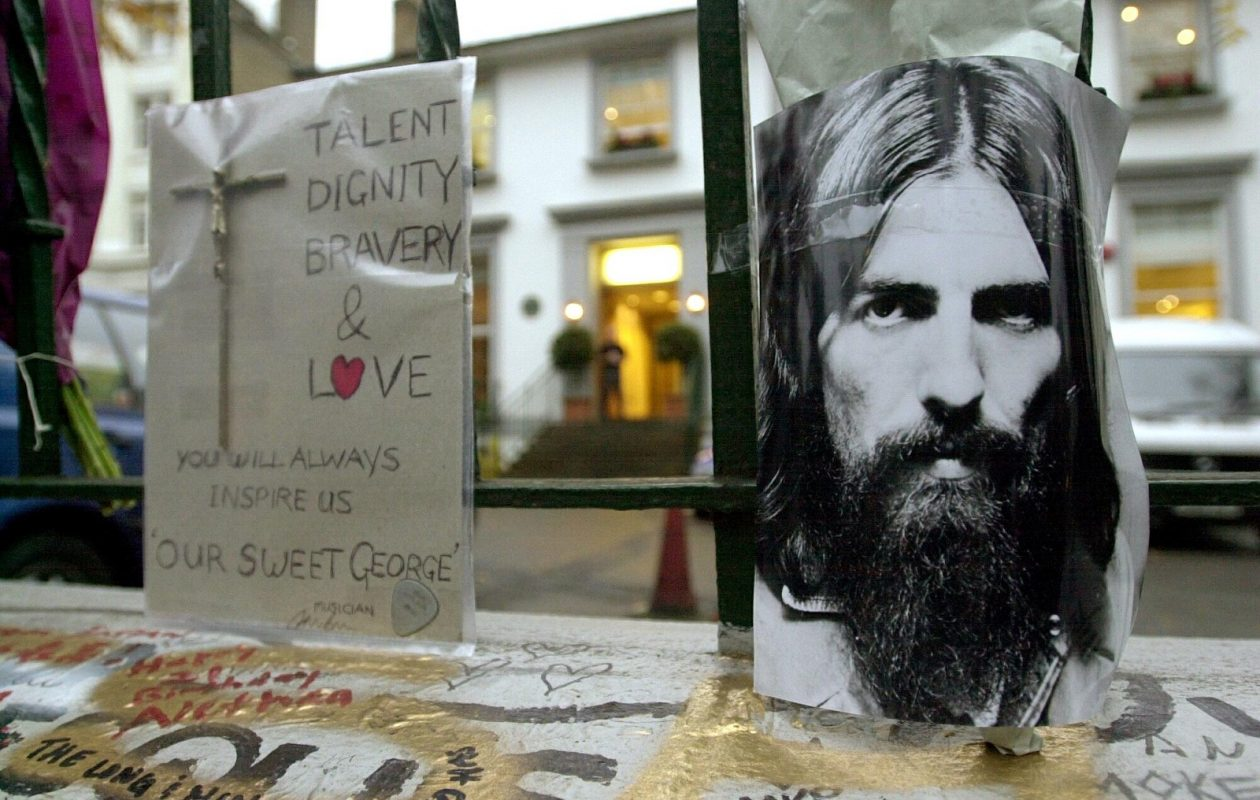 A picture taken 30 November 2001 at Abbey Road studios in London, where fans came to leave flowers and pictures in memory of British former Beatle George Harrison who died from cancer a day previously. (Nicolas Asfouri/AFP/Getty Images)