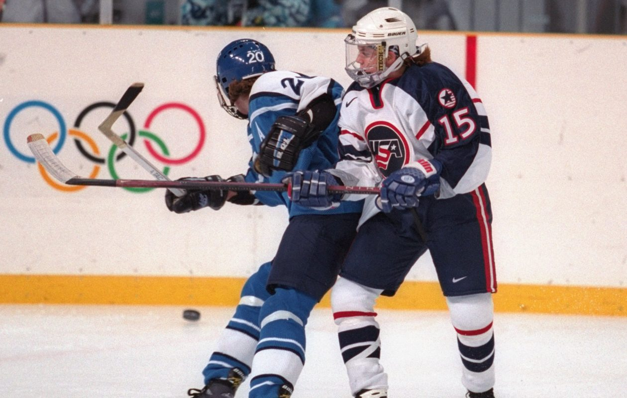 Shelley Looney of the United States and Kirsi Maaria Haenninen of Finland fight for the puck during the 1998 Winter Olympic Games in Nagano, Japan. (Brian Bahr /Allsport via Getty Images)