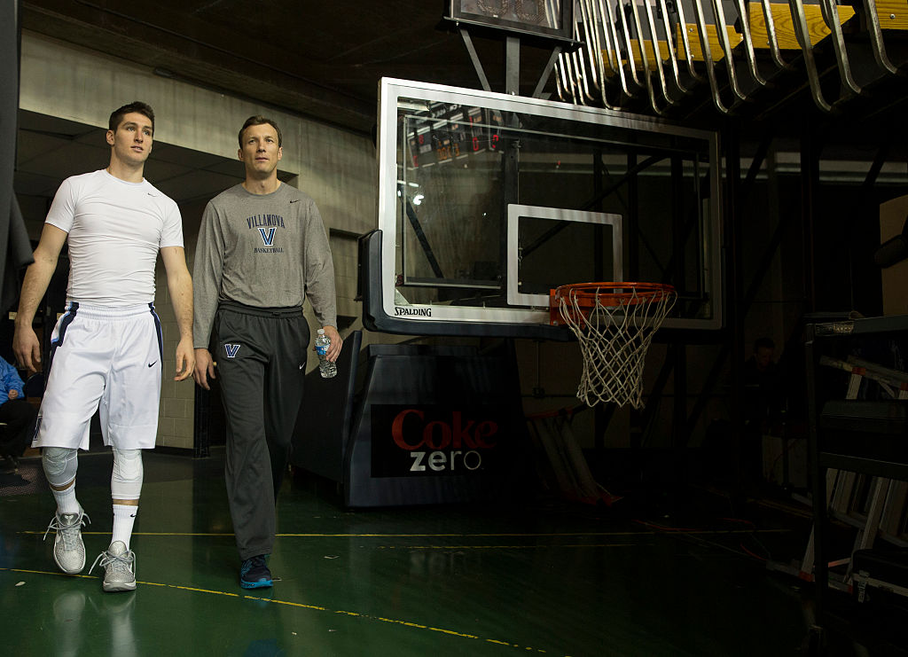 Ryan Arcidiacono #15 of the Villanova Wildcats and associate head coach Baker Dunleavy walk onto the court prior to the game against the Nebraska Cornhuskers on November 17, 2015 at the Pavilion in Villanova, Pennsylvania. (Photo by Mitchell Leff/Getty Images)